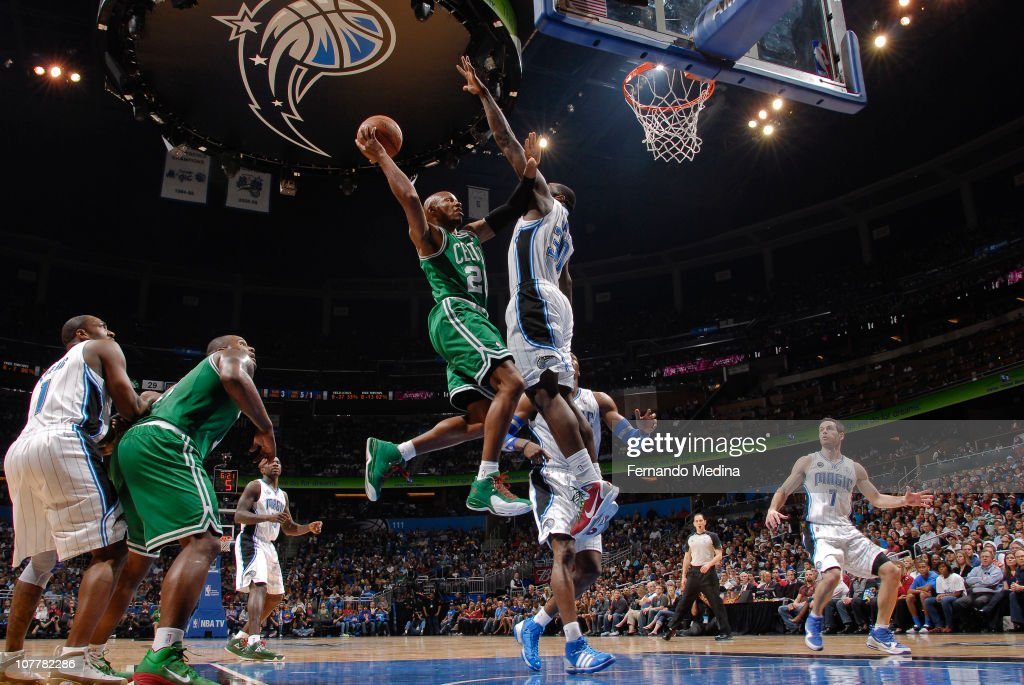 <a gi-track='captionPersonalityLinkClicked' href=/galleries/search?phrase=Ray+Allen&family=editorial&specificpeople=201511 ng-click='$event.stopPropagation()'>Ray Allen</a> #20 of the Boston Celtics takes the ball to the basket against <a gi-track='captionPersonalityLinkClicked' href=/galleries/search?phrase=Brandon+Bass&family=editorial&specificpeople=233806 ng-click='$event.stopPropagation()'>Brandon Bass</a> #30 of the Orlando Magic on December 25, 2010 at the Amway Center in Orlando, Florida.