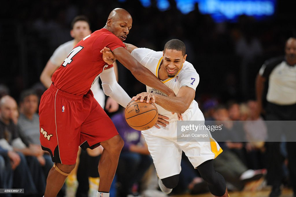 <a gi-track='captionPersonalityLinkClicked' href=/galleries/search?phrase=Ray+Allen&family=editorial&specificpeople=201511 ng-click='$event.stopPropagation()'>Ray Allen</a> #34 of the Miami Heat and <a gi-track='captionPersonalityLinkClicked' href=/galleries/search?phrase=Xavier+Henry&family=editorial&specificpeople=5792007 ng-click='$event.stopPropagation()'>Xavier Henry</a> #7 of the Los Angeles Lakers attempt to gain procession of the basketball during a game at STAPLES Center on December 25, 2013 in Los Angeles, California.
