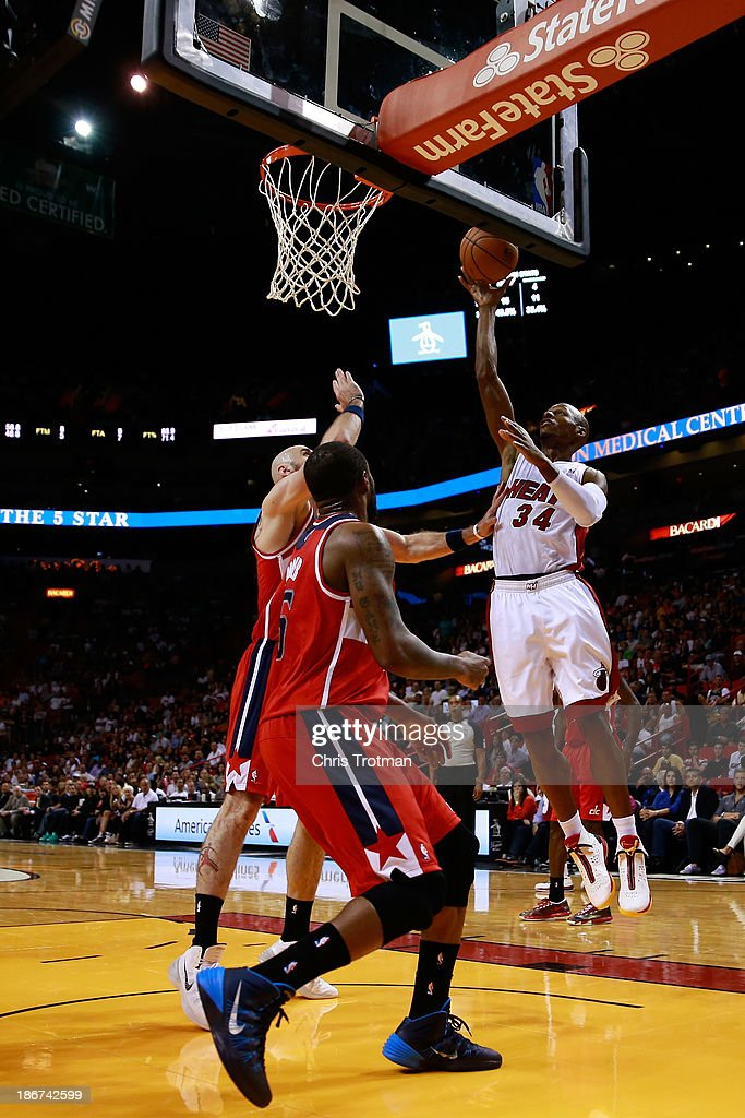 Ray Allen #34 of the Miami Heat attempts a layup as Marcin Gortat #4 of the Washington Wizards and Eric Maynor #6 of the Washington Wizards look on at American Airlines Arena on November 3, 2013 in Miami, Florida.
