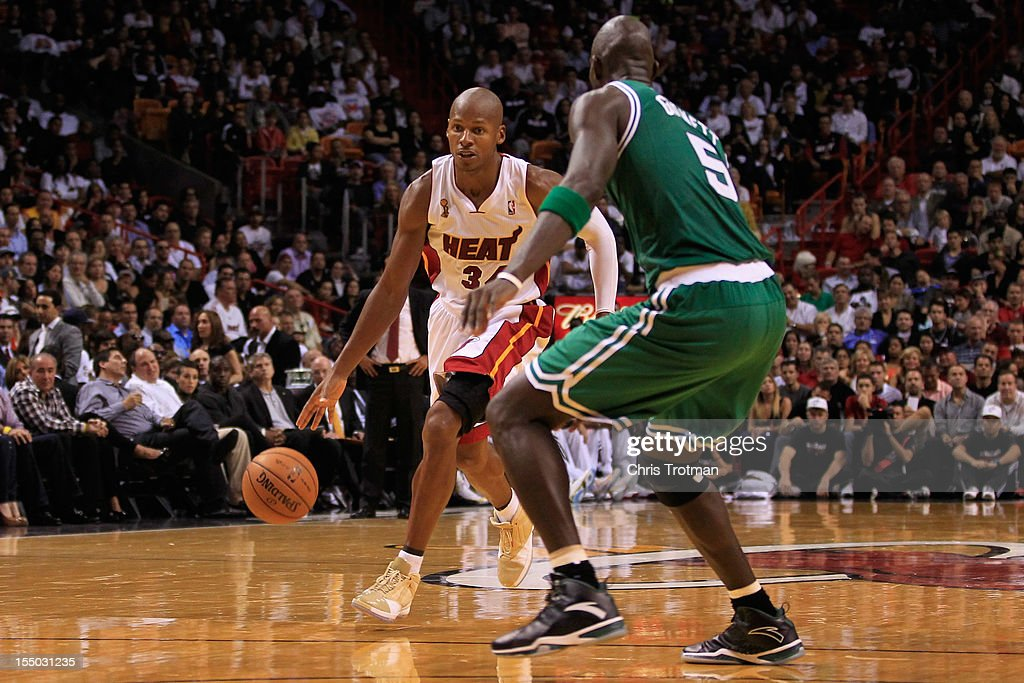 Ray Allen #34 of the Miami Heat drives against Kevin Garnett #5 of the Boston Celtics at American Airlines Arena on October 30, 2012 in Miami, Florida.