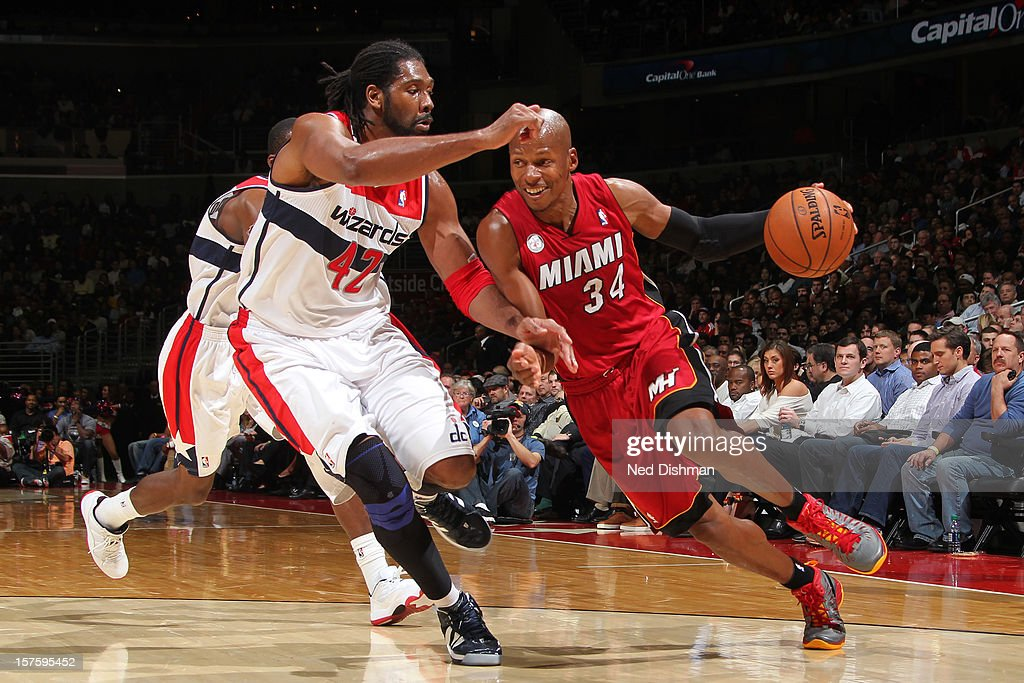 Ray Allen #34 of the Miami Heat drives against Nene #42 of the Washington Wizards during the game at the Verizon Center on December 4, 2012 in Washington, DC.