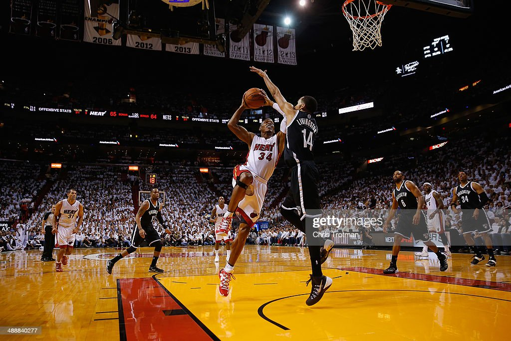 <a gi-track='captionPersonalityLinkClicked' href=/galleries/search?phrase=Ray+Allen&family=editorial&specificpeople=201511 ng-click='$event.stopPropagation()'>Ray Allen</a> #34 of the Miami Heat drives against <a gi-track='captionPersonalityLinkClicked' href=/galleries/search?phrase=Shaun+Livingston&family=editorial&specificpeople=202955 ng-click='$event.stopPropagation()'>Shaun Livingston</a> #14 of the Brooklyn Nets during Game Two of the Eastern Conference Semifinals of the 2014 NBA Playoffs at American Airlines Arena on May 8, 2014 in Miami, Florida.