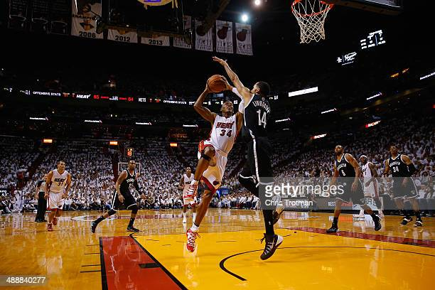Ray Allen of the Miami Heat drives against Shaun Livingston of the Brooklyn Nets during Game Two of the Eastern Conference Semifinals of the 2014 NBA...