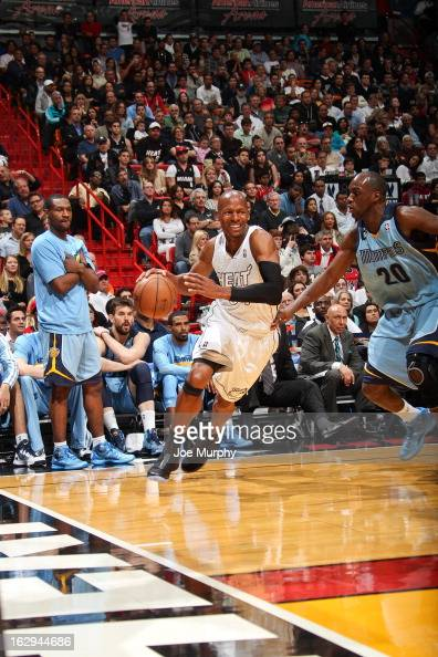 Ray Allen of the Miami Heat drives along the baseline against Quincy Pondexter of the Memphis Grizzlies on March 1 2013 at American Airlines Arena in...