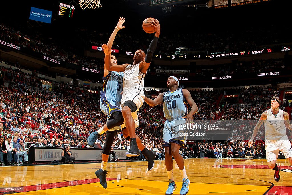 Ray Allen #34 of the Miami Heat drives to the basket against Austin Daye #5 of the Memphis Grizzlies on March 1, 2013 at American Airlines Arena in Miami, Florida.