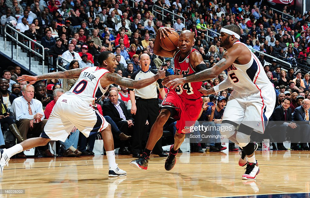 Ray Allen #34 of the Miami Heat drives to the basket against Josh Smith #5 of the Atlanta Hawks on February 20, 2013 at Philips Arena in Atlanta, Georgia.