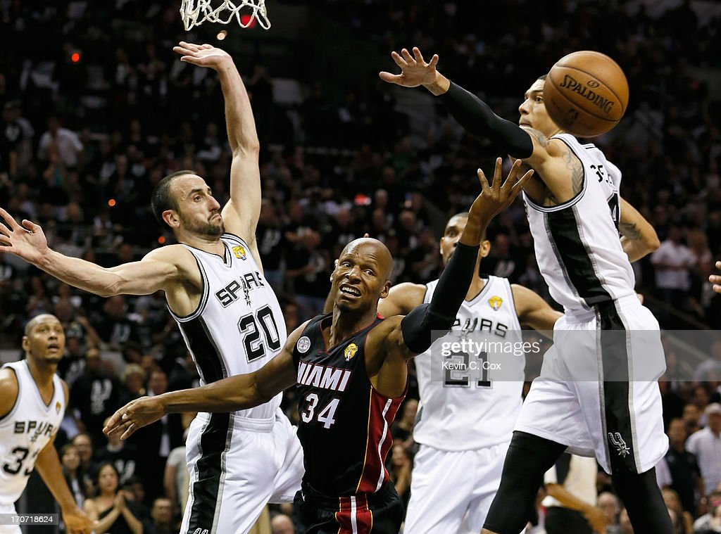 Ray Allen #34 of the Miami Heat goes up for a shot against Manu Ginobili #20 and Danny Green #4 of the San Antonio Spurs in the second half during Game Five of the 2013 NBA Finals at the AT&T Center on June 16, 2013 in San Antonio, Texas.