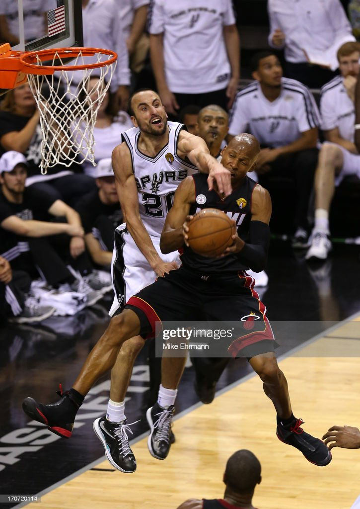 Ray Allen #34 of the Miami Heat goes up for a shot against Manu Ginobili #20 of the San Antonio Spurs in the fourth quarter during Game Five of the 2013 NBA Finals at the AT&T Center on June 16, 2013 in San Antonio, Texas.