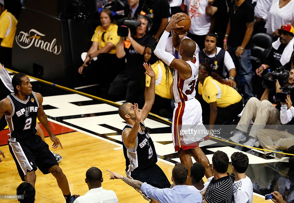 Ray Allen #34 of the Miami Heat makes a game-tying three-pointer over Tony Parker #9 of the San Antonio Spurs in the fourth quarter during Game Six of the 2013 NBA Finals at AmericanAirlines Arena on June 18, 2013 in Miami, Florida.