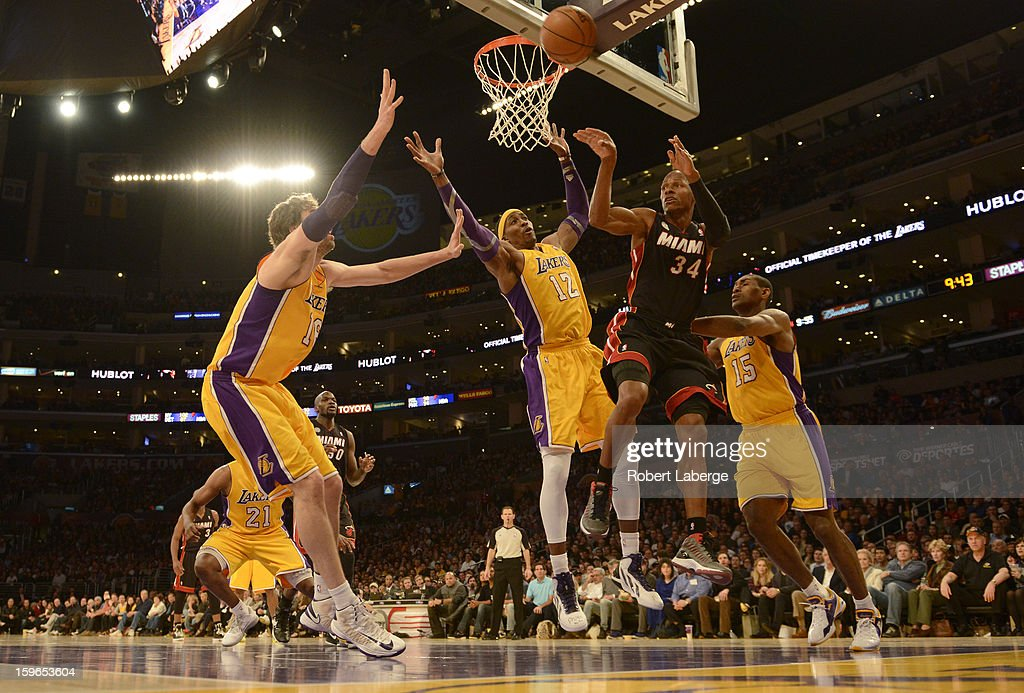 Ray Allen #34 of the Miami Heat passes to a teammate as Pau Gasol #16, Dwight Howard #12 and Metta World Peace of the Los Angeles Lakers try to block him at Staples Center on January 17, 2013 in Los Angeles, California.