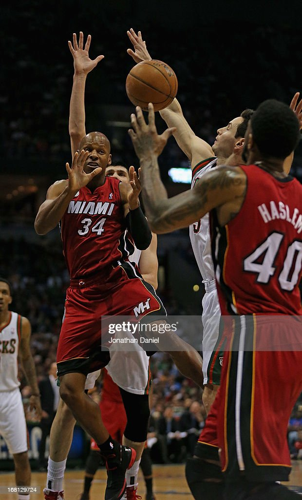 Ray Allen #34 of the Miami Heat passes to Udonis Haslem #40 against the Milwaukee Bucks in Game Four of the Eastern Conference Quarterfinals during the 2013 NBA Playoffs at the Bradley Center on April 28, 2013 in Milwaukee, Wisconsin. The Heat defeated the Bucks 88-77.
