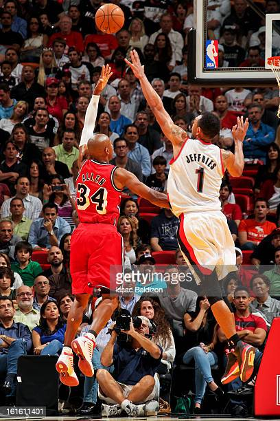 Ray Allen of the Miami Heat shoots a layup against Jared Jeffries of the Portland Trail Blazers on February 12 2013 at American Airlines Arena in...