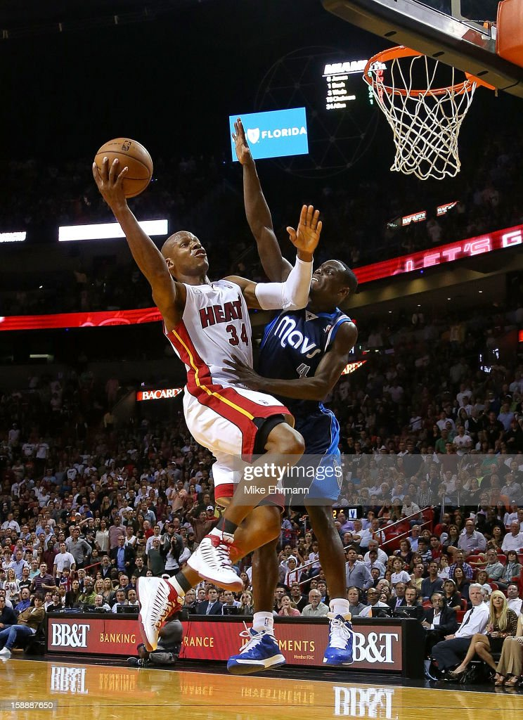 Ray Allen #34 of the Miami Heat shoots over Darren Collison #4 of the Dallas Mavericks during a game at American Airlines Arena on January 2, 2013 in Miami, Florida.