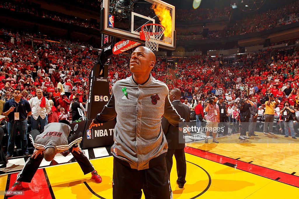 Ray Allen #34 of the Miami Heat stretches as pyrotechnics go off before playing the Oklahoma City Thunder in a Christmas Day game on December 25, 2012 at American Airlines Arena in Miami, Florida.