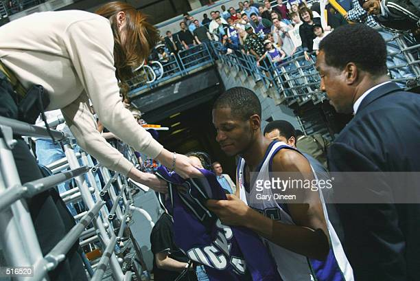 Ray Allen of the Milwaukee Bucks signs an autograph after the game against the Charlotte Hornets at Bradley Center in Milwaukee Wisconsin on April 14...