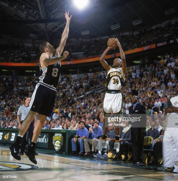 Ray Allen of the Seattle Sonics shoots a jump shot over Luke Ridnour of the San Antonio Spurs in Game four of the Western Conference Semifinals...