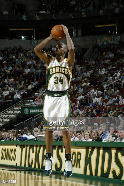 Ray Allen of the Seattle Sonics shoots against the Dallas Mavericks during the game at Key Arena on April 10 2004 in Seattle Washington The Sonics...