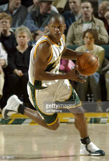 Ray Allen of the Seattle SuperSonics advances the ball against the Orlando Magic on March 21 2004 at Key Arena in Seattle Washington NOTE TO USER...