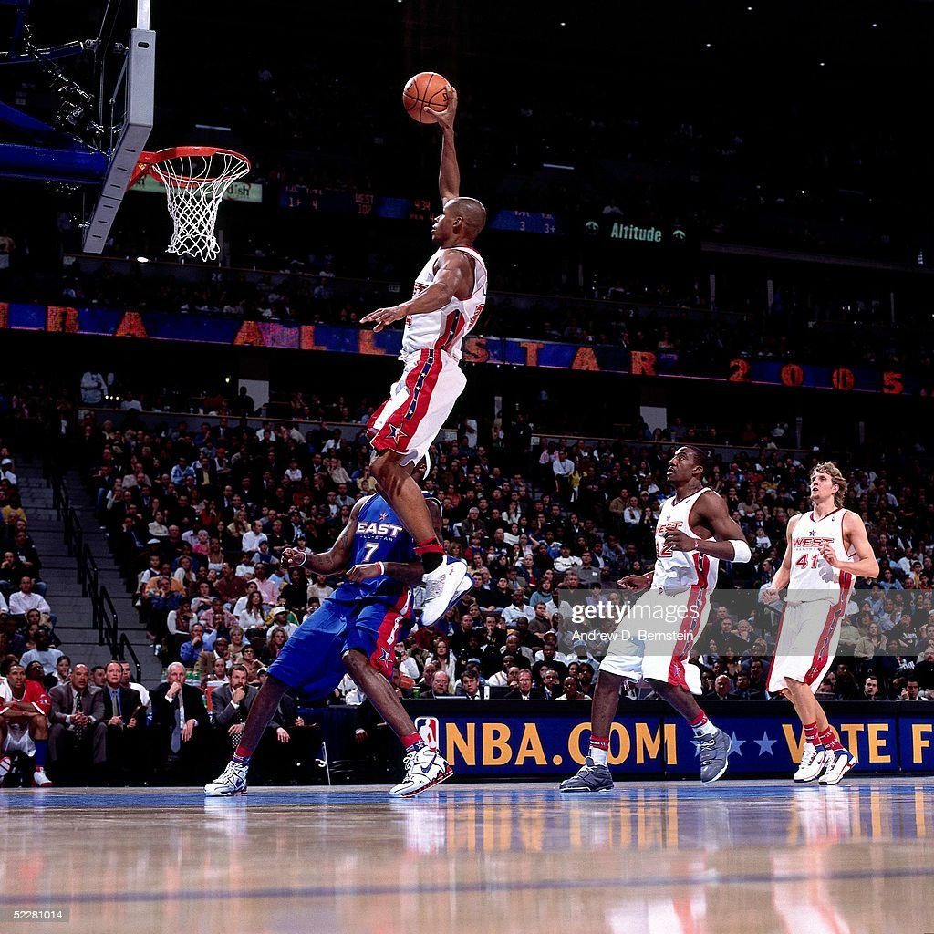 Ray Allen #34 of the Western Conference All-Stars dunks against Jermaine O'Neal #7 of the Eastern Conference All-Stars during the 2005 All-Star Game on February 20, 2005 at The Pepsi Center in Denver, Colorado.