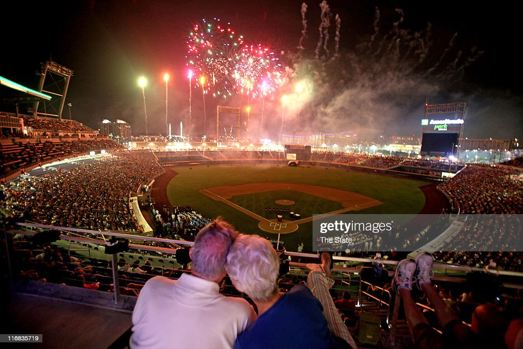 Ray and Laura Beth Barr watch the fireworks during the 2011 College World Series opening ceremony at TD Ameritrade Park in Omaha Nebraska Friday June...