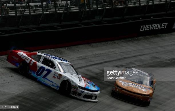 Ray Black II driver of the Scuba Life Chevrolet spins in front of Elliott Sadler driver of the Armour 150 Years Chevrolet during the NASCAR XFINITY...