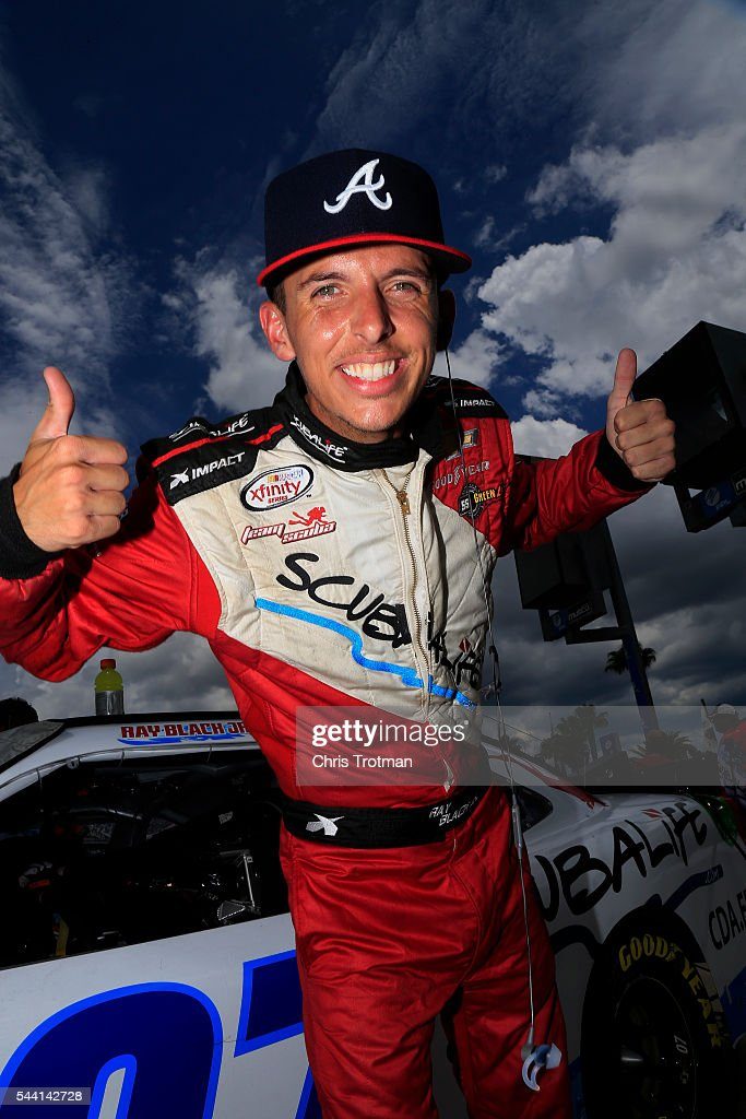 Ray Black Jr., driver of the #07 Scuba Life Chevrolet, poses on the grid during qualifying for the NASCAR XFINITY Series Subway Firecracker 250 at Daytona International Speedway on July 1, 2016 in Daytona Beach, Florida.