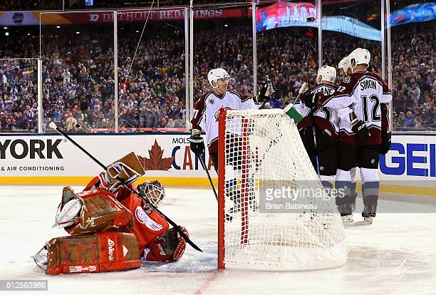 Ray Bourque Mike Keane Stephan Yelle and Chris Simon of the Colorado Avalanche Alumni celebrate Yelle's goal as goaltender Manny Legace of the...