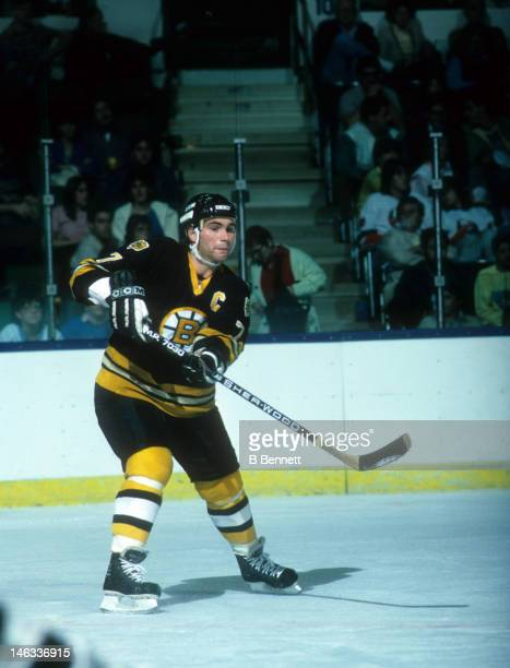 Ray Bourque of the Boston Bruins passes the puck during an NHL game against the New York Islanders circa 1985 at the Nassau Coliseum in Uniondale New...