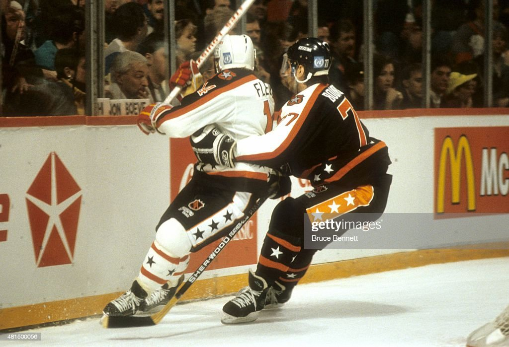 Ray Bourque of the Wales Conference and the Boston Bruins checks Theoren Fleury of the Campbell Conference and the Calgary Flames during the 1991...