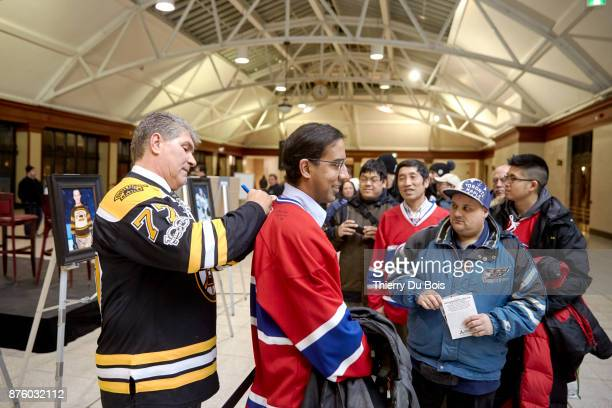 Ray Bourque signs a jersey during a QA session as part of the NHL Centennial 100 Celebration on November 18 2017 at the Bell Centre in Montreal...