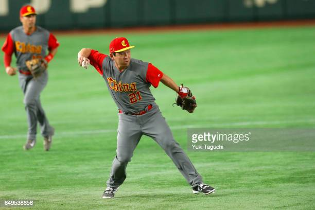Ray Chang throws to first base in second inning during Game 2 of Pool B between Team China and Team Cuba at the Tokyo Dome on Wednesday March 8 2017...