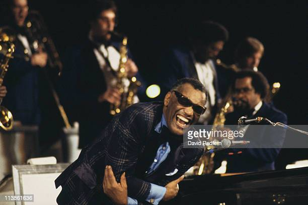 Ray Charles US singer and pianist leaning forward onto a piano during a live concert performance circa 1970