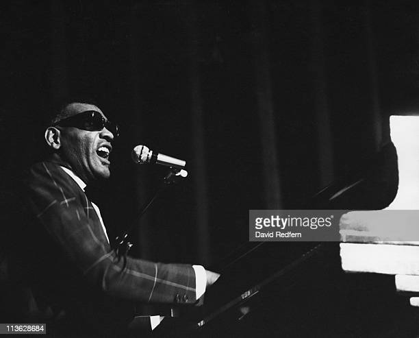Ray Charles US singer and pianist singing into a microphone while playing the piano during a live concert performance at the Jazz Expo at Hammersmith...