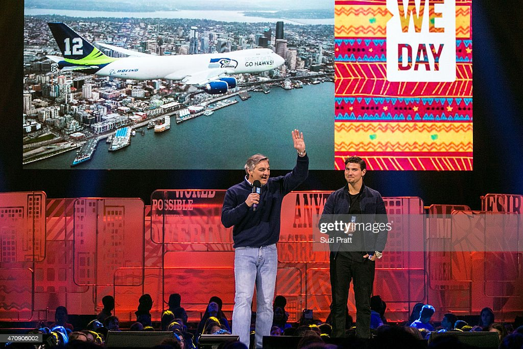 Ray Conner, CEO of Boeing Commercial Airplanes, and actor Luke Bilyk speak at We Day at KeyArena on April 23, 2015 in Seattle, Washington.