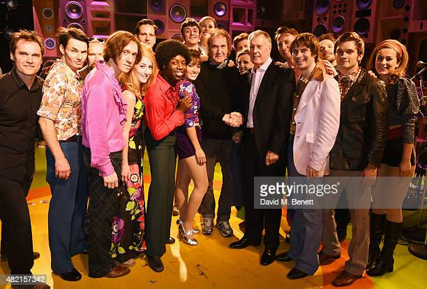 Ray Davies and Sir Geoff Hurst pose onstage with cast members following a performance of 'Sunny Afternoon' at Harold Pinter Theatre on July 27 2015...