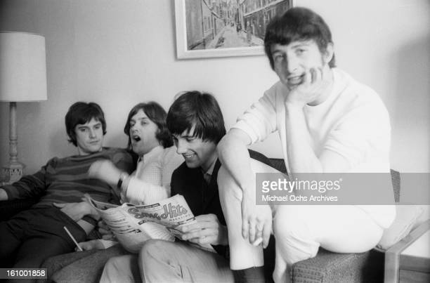 Ray Davies Dave Davies Mick Avory and Peter Quaife of the rock group 'The Kinks' relax in their hotel room in August 1965 in New York New York