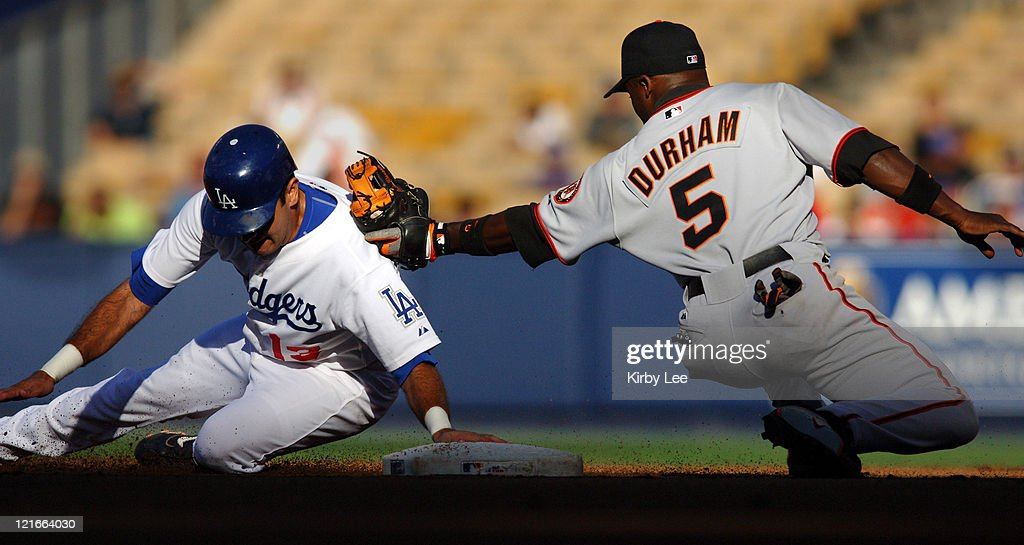 Ray Durham of the San Francisco Giants tags out Oscar Robles of the Los Angeles Dodgers at second base on a stolen base attempt in the first inning...