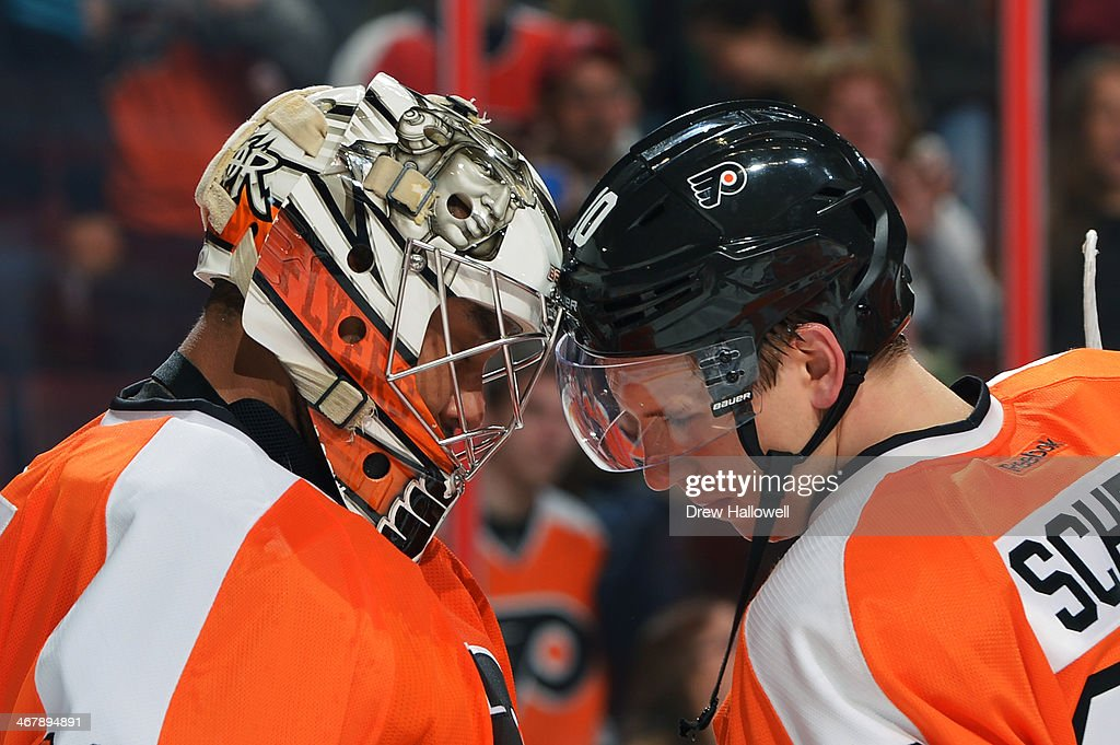 <a gi-track='captionPersonalityLinkClicked' href=/galleries/search?phrase=Ray+Emery&family=editorial&specificpeople=218109 ng-click='$event.stopPropagation()'>Ray Emery</a> #29 and <a gi-track='captionPersonalityLinkClicked' href=/galleries/search?phrase=Brayden+Schenn&family=editorial&specificpeople=4782304 ng-click='$event.stopPropagation()'>Brayden Schenn</a> #10 of the Philadelphia Flyers bump heads after a 2-1 win over the Calgary Flames at the Wells Fargo Center on February 8, 2014 in Philadelphia, Pennsylvania.