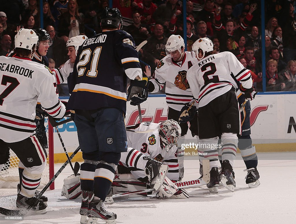 <a gi-track='captionPersonalityLinkClicked' href=/galleries/search?phrase=Ray+Emery&family=editorial&specificpeople=218109 ng-click='$event.stopPropagation()'>Ray Emery</a> #30 of the Chicago Blackhawks covers the puck in a crowd of players in an NHL game against the St. Louis Blues on February 28, 2013 at Scottrade Center in St. Louis, Missouri.