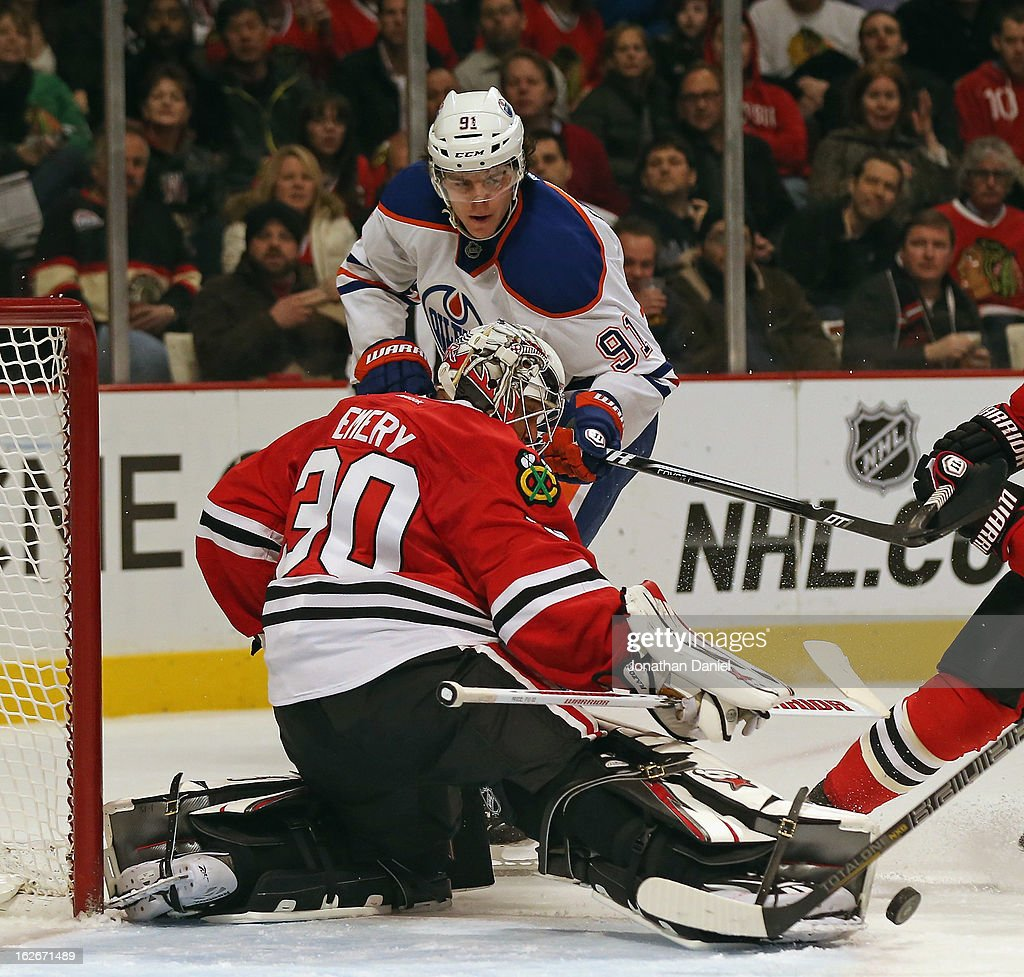 <a gi-track='captionPersonalityLinkClicked' href=/galleries/search?phrase=Ray+Emery&family=editorial&specificpeople=218109 ng-click='$event.stopPropagation()'>Ray Emery</a> #30 of the Chicago Blackhawks makes a save against Magnus Paajarvi #91 of the Edmonton Oilers at the United Center on February 25, 2013 in Chicago, Illinois. The Blackhawks defeated the Oilers 3-2 in overtime.