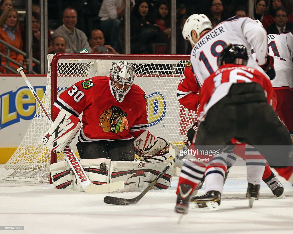 Ray Emery #30 of the Chicago Blackhawks stops a shot by R.J. Umberger #18 of the Columbus Blue Jackets at the United Center on March 1, 2013 in Chicago, Illinois.
