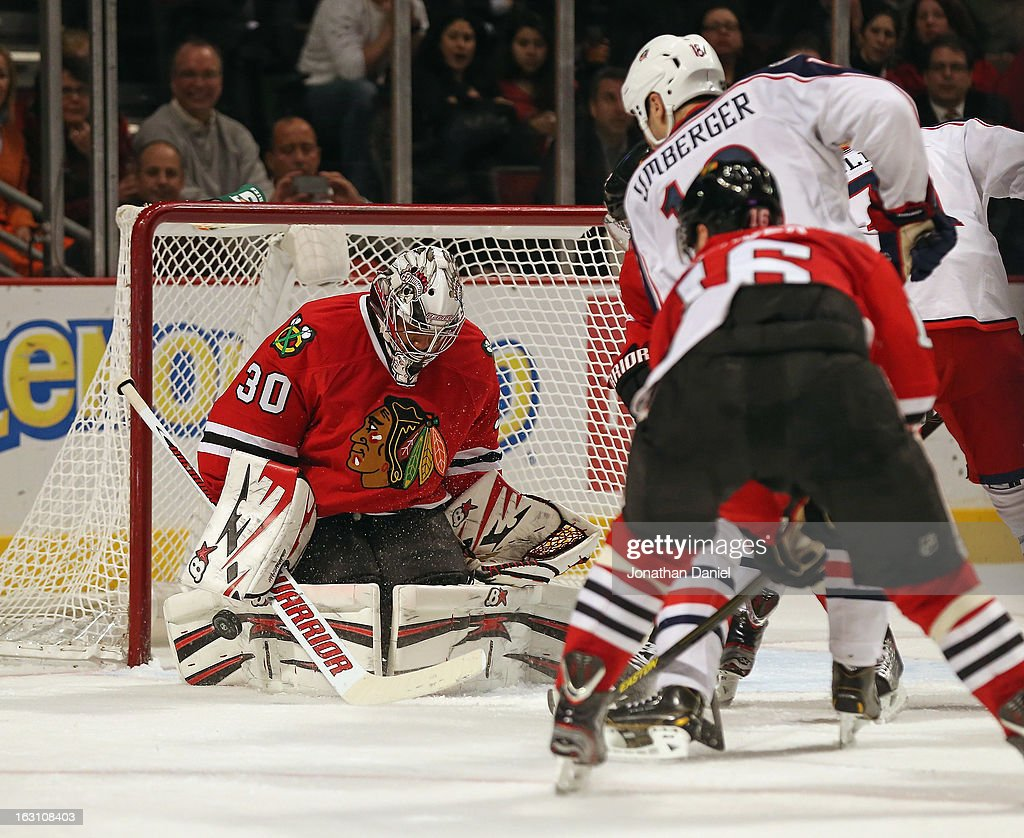 Ray Emery #30 of the Chicago Blackhawks stops a shot by R.J. Umberger #18 of the Columbus Blue Jackets at the United Center on March 1, 2013 in Chicago, Illinois. The Blackhawks defeated the Blue Jackets 4-3 in overtime.