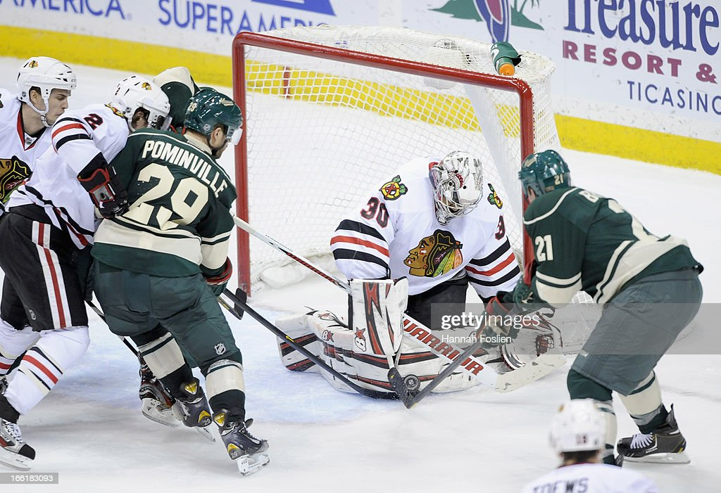 <a gi-track='captionPersonalityLinkClicked' href=/galleries/search?phrase=Ray+Emery&family=editorial&specificpeople=218109 ng-click='$event.stopPropagation()'>Ray Emery</a> #30 of the Chicago Blackhawks stops the shot by <a gi-track='captionPersonalityLinkClicked' href=/galleries/search?phrase=Kyle+Brodziak&family=editorial&specificpeople=2165412 ng-click='$event.stopPropagation()'>Kyle Brodziak</a> #21 of the Minnesota Wild during the third period of the game on April 9, 2013 at Xcel Energy Center in St Paul, Minnesota. The Blackhawks defeated the Wild 1-0.