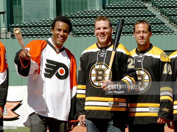 Ray Emery of the Philadelphia Flyers and Shawn Thornton and Mark Krejci of the Boston Bruins stand at Fenway Park during a news conference to...
