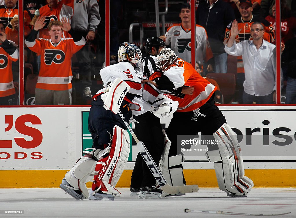 Ray Emery #29 of the Philadelphia Flyers fights with Braden Holtby #70 of the Washington Capitals during the third period at the Wells Fargo Center on November 1, 2013 in Philadelphia, Pennsylvania. The Capitals shutout the Flyers 7-0.
