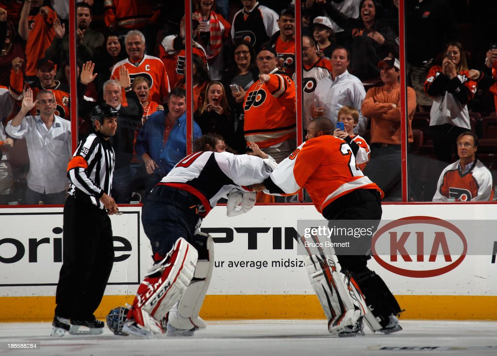 <a gi-track='captionPersonalityLinkClicked' href=/galleries/search?phrase=Ray+Emery&family=editorial&specificpeople=218109 ng-click='$event.stopPropagation()'>Ray Emery</a> #29 of the Philadelphia Flyers fights with <a gi-track='captionPersonalityLinkClicked' href=/galleries/search?phrase=Braden+Holtby&family=editorial&specificpeople=5370964 ng-click='$event.stopPropagation()'>Braden Holtby</a> #70 of the Washington Capitals during the third period at the Wells Fargo Center on November 1, 2013 in Philadelphia, Pennsylvania. The Capitals shutout the Flyers 7-0.