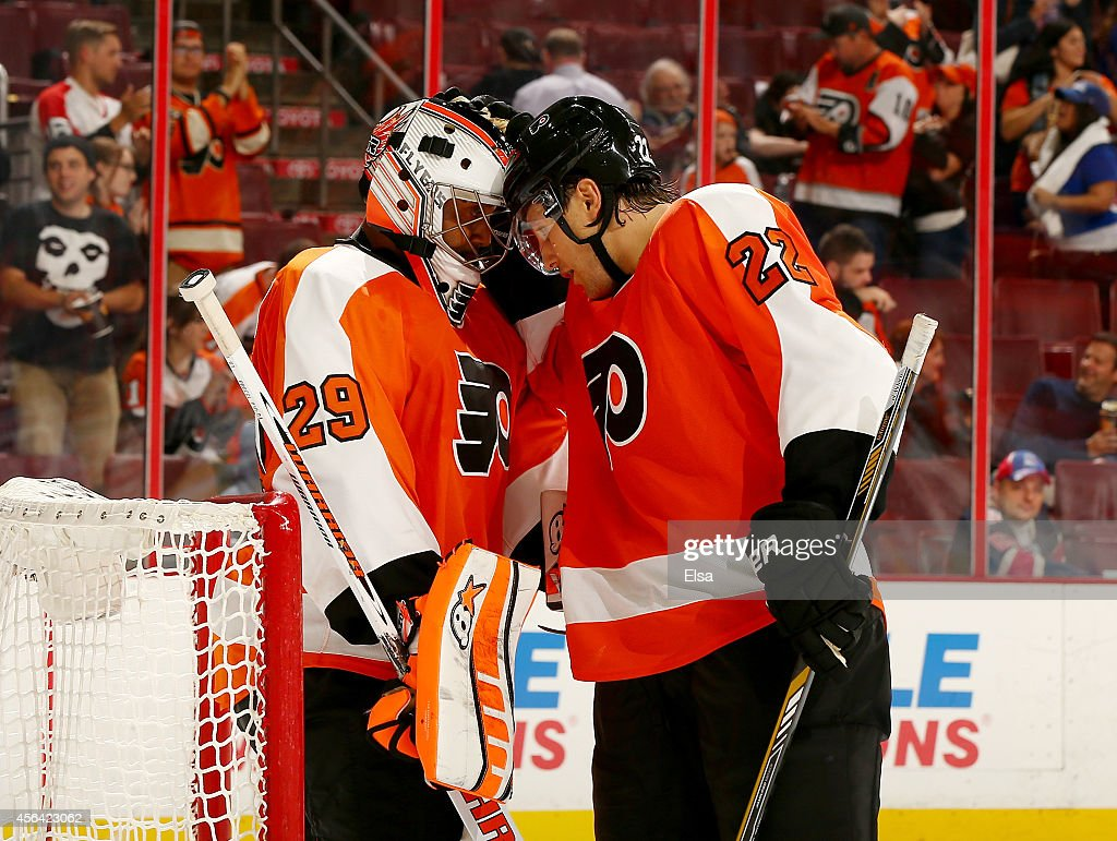 <a gi-track='captionPersonalityLinkClicked' href=/galleries/search?phrase=Ray+Emery&family=editorial&specificpeople=218109 ng-click='$event.stopPropagation()'>Ray Emery</a> #29 of the Philadelphia Flyers is celebrates the win with teammate <a gi-track='captionPersonalityLinkClicked' href=/galleries/search?phrase=Luke+Schenn&family=editorial&specificpeople=4254202 ng-click='$event.stopPropagation()'>Luke Schenn</a> #22 after the game against the New York Rangers on September 30, 2014 at the Wells Fargo Center in Philadelphia, Pennsylvania.The Philadelphia Flyers defeated the New York Rangers 4-2.