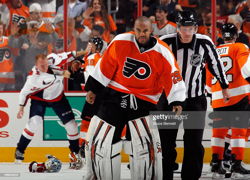 <a gi-track='captionPersonalityLinkClicked' href=/galleries/search?phrase=Ray+Emery&family=editorial&specificpeople=218109 ng-click='$event.stopPropagation()'>Ray Emery</a> #29 of the Philadelphia Flyers leaves the ice following a fight with <a gi-track='captionPersonalityLinkClicked' href=/galleries/search?phrase=Braden+Holtby&family=editorial&specificpeople=5370964 ng-click='$event.stopPropagation()'>Braden Holtby</a> #70 of the Washington Capitals at the Wells Fargo Center on November 1, 2013 in Philadelphia, Pennsylvania.