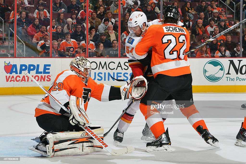 <a gi-track='captionPersonalityLinkClicked' href=/galleries/search?phrase=Ray+Emery&family=editorial&specificpeople=218109 ng-click='$event.stopPropagation()'>Ray Emery</a> #29 of the Philadelphia Flyers makes a save as <a gi-track='captionPersonalityLinkClicked' href=/galleries/search?phrase=Luke+Schenn&family=editorial&specificpeople=4254202 ng-click='$event.stopPropagation()'>Luke Schenn</a> #22 holds off David Jones #54 of the Calgary Flames at the Wells Fargo Center on February 8, 2014 in Philadelphia, Pennsylvania.