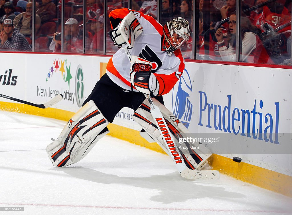 Ray Emery #29 of the Philadelphia Flyers plays the puck during the game against the New Jersey Devils at the Prudential Center on November 2, 2013 in Newark, New Jersey.